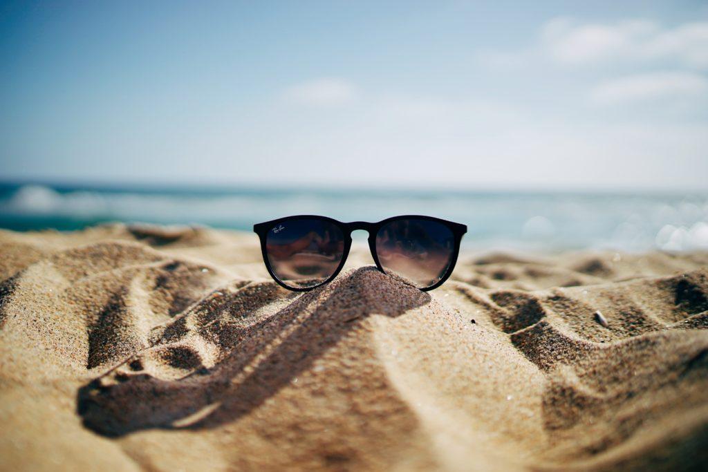 summer heatwave sunglasses on a beach
